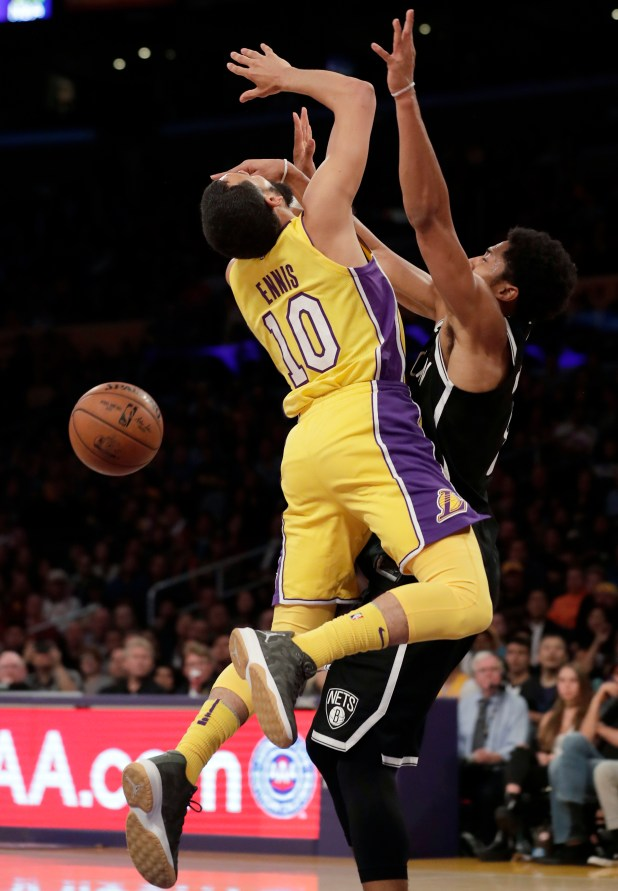 Los Angeles Lakers guard Tyler Ennis, left, is fouled by Brooklyn Nets guard Spencer Dinwiddie during the first half of an NBA basketball game, Friday, Nov. 3, 2017, in Los Angeles. (AP Photo/Ryan Kang)