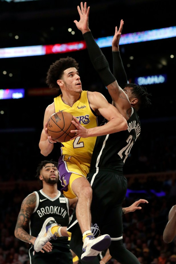 Los Angeles Lakers guard Lonzo Ball goes to the basket against Brooklyn Nets forward Rondae Hollis-Jefferson, right, during the first half of an NBA basketball game, Friday, Nov. 3, 2017, in Los Angeles. (AP Photo/Ryan Kang)