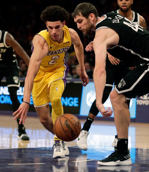 Brooklyn Nets center Tyler Zeller, right, knocks the ball from Los Angeles Lakers guard Lonzo Ball during the first half of an NBA basketball game, Friday, Nov. 3, 2017, in Los Angeles. (AP Photo/Ryan Kang)
