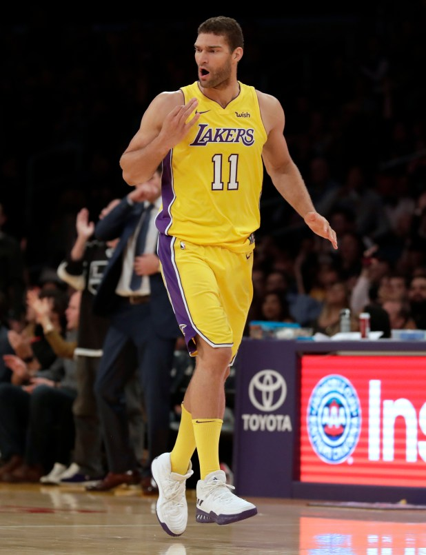 Lakers center Brook Lopez holds up three fingers after making one of his six 3-pointers during the second half of Friday's game against the Brooklyn Nets at Staples Center. (AP Photo/Ryan Kang)