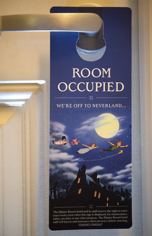 "The Disneyland hotels has new door signs which went into effect Dec. 21, according to resort spokeswoman Suzi Brown. Formerly ""Do Not Disturb"" signs are replaced with ""Room occupied."" At the bottom in smaller type reads,"" The Disney Resort Hotel and its staff reserve the right to enter your room, even when the sign is displayed, for maintenance, safety, security or any other purpose. The Disney Resort hotel staff will knock and announce their presence before entering."" Photographed Monday, Jan. 8, 2018. (Photo by Cindy Yamanaka, Orange County Register/SCNG)"