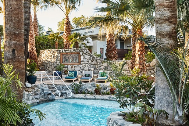 The pool area lagoon at Two Bunch Palms feels like a hidden desert hideaway.