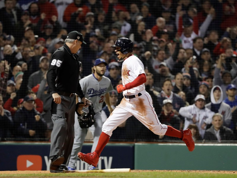 22de60282 Boston Red Sox s Mookie Betts scores an RBI double by Andrew Benintendi  during the first inning of Game 1 of the World Series baseball game against  the Los ...
