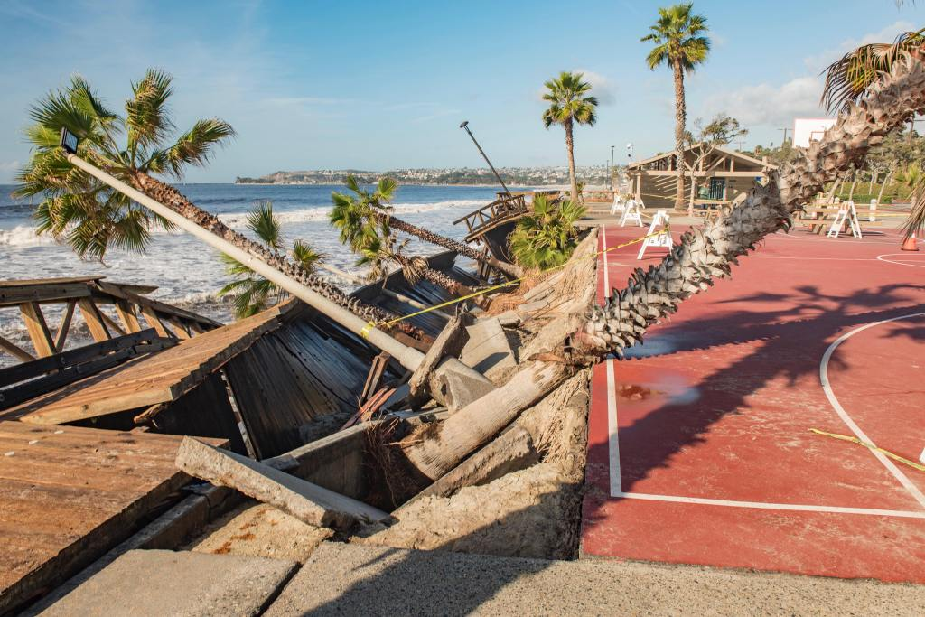 Capo Beach crumbles with walkway destroyed palms uprooted