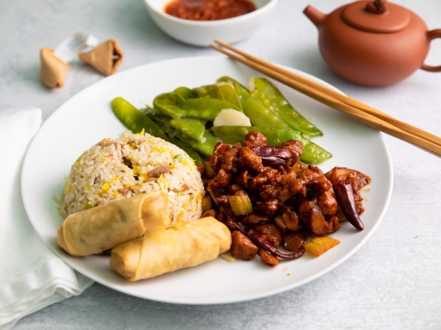 Kung pao chicken, fried rice, egg rolls and snow peas from Ta Chen in Garden Grove (Photo by Brad A. Johnson, Orange County Register/SCNG)