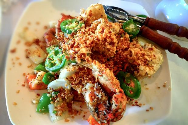 The wok-fried crab is loaded with garlic, jalapenos and dried chilies at Garlic & Chives
