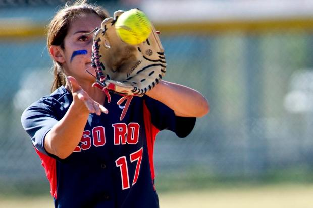 Tesoro second baseman Kiana Cisneros fields this line drive during Monday's Sea View League game against Trabuco Hills at Tesoro High.