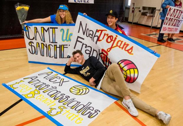 Huntington Beach High student athletes Cami Sanchez, Alex Anastassiades, and Noah Franklin, from left, pose for photos with their posters after they signed their letters of intent in Huntington Beach on Wednesday, February 1, 2017. Sanchez signed to play beach volleyball for UCLA, Anastassiades signed to play volleyball for Long Beach State and Franklin signed to play volleyball for USC. (Photo by Paul Rodriguez, Orange County Register/SCNG)