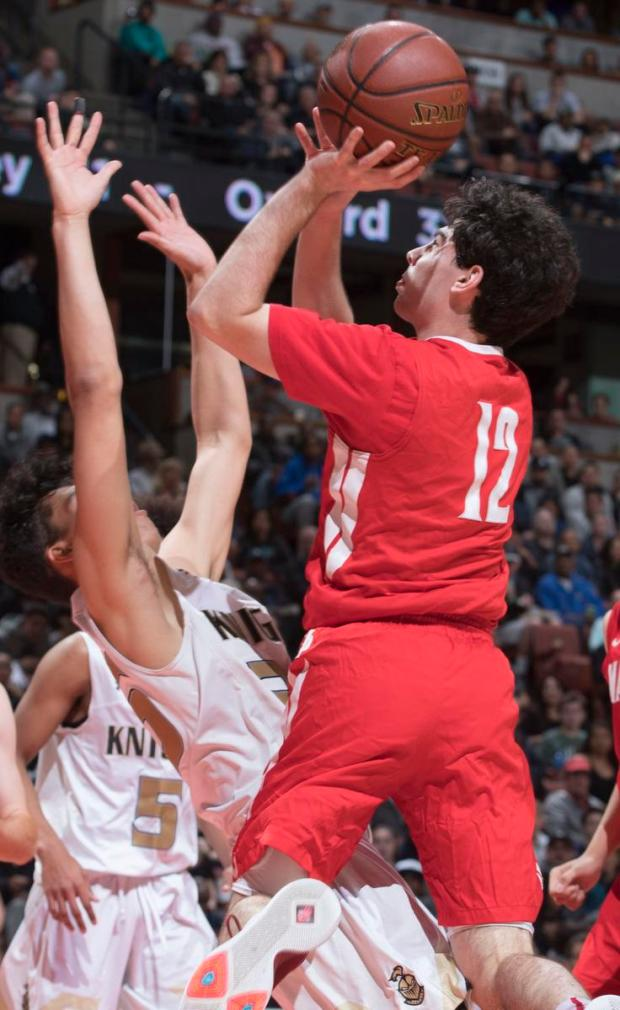 Mater Dei's Spencer Freedman shoots over Bishop Montgomery's Fletcher Tynen during the first half of the CIF-SS Open Division championship game at Honda Center in Anaheim on Saturday, March 4, 2017. (Photo by Kevin Sullivan, Orange County Register/SCNG)