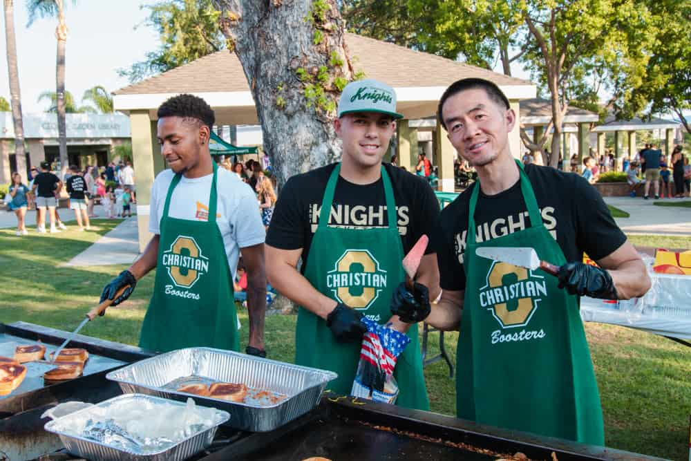 Ontario Christian Staff and Coaches prepare food at the Kickoff Cookout