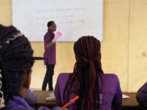 The lecturer delivering lecture in the classroom