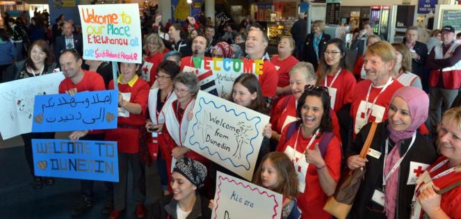 Red Cross volunteers welcome the first group of Syrian refugees at Dunedin Airport in 2016. Photo...