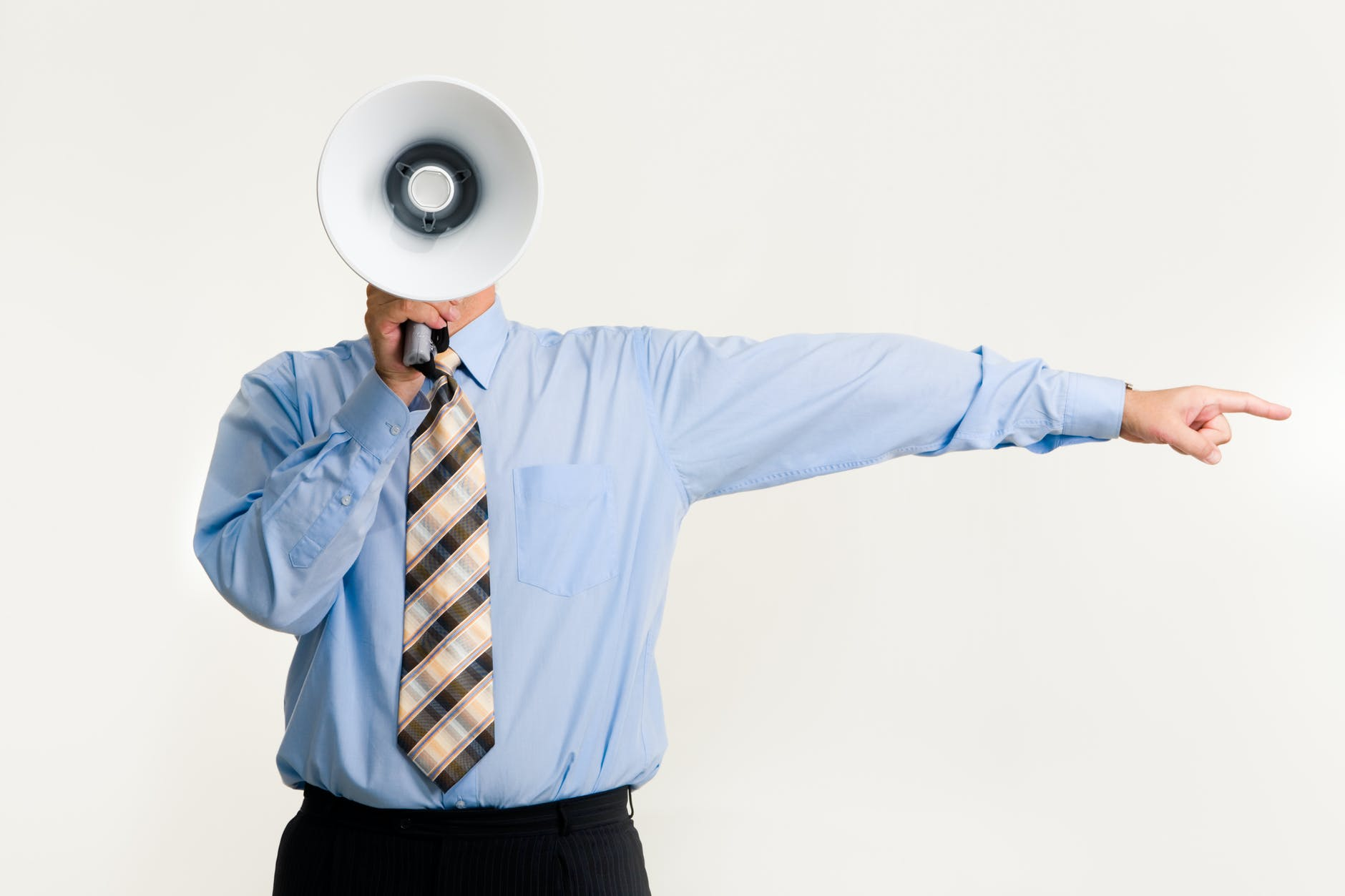 man with megaphone pointing