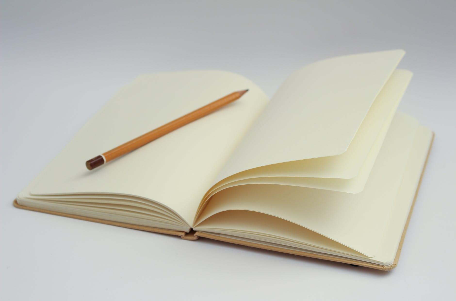 caderno escrever lápis começar