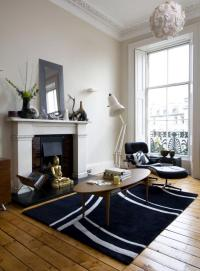 """Room with fireplace """"Lounge Chair"""" Eames 