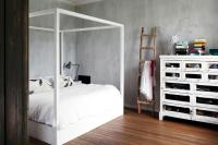 Canopy bed against the wall with minimalist faux finish ...