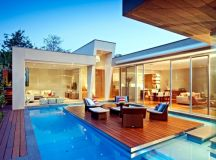Modern House in Canterbury – A wooden deck by the pool ...