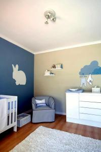 Blue and beige wall with a rabbit model in modern baby ...