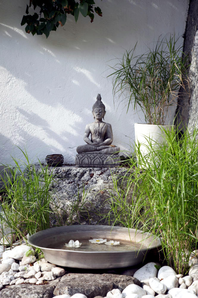 Buddha statue in the garden of natural stone  Interior Design Ideas  Ofdesign