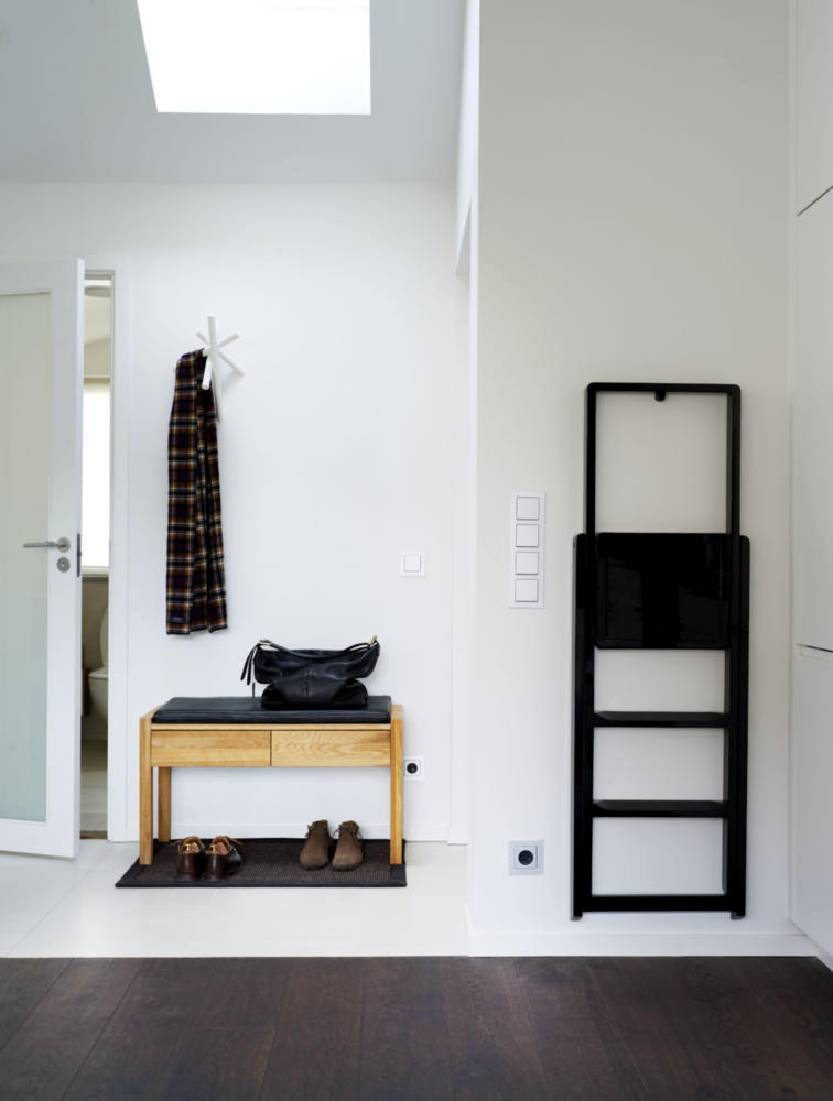 Tread black bench in the hallway and wood minimalist