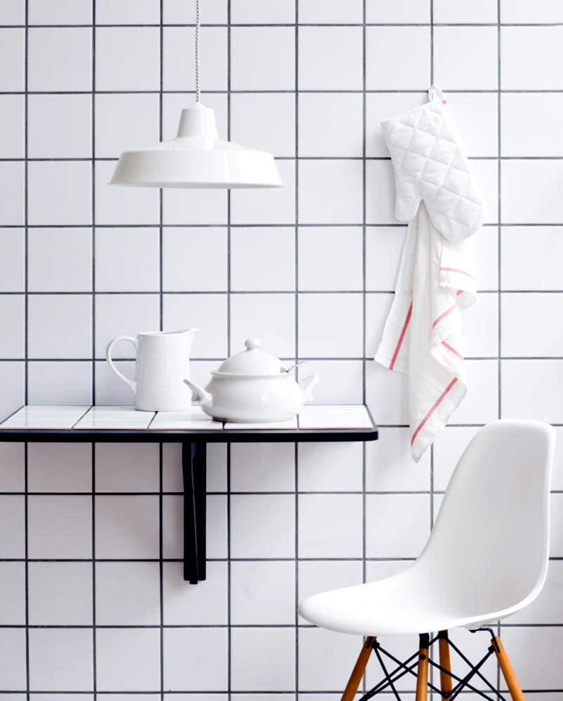 Square, white tiles on the wall and table