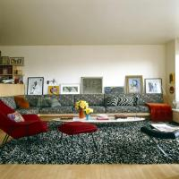 Living room with black sofa and white patterns and deep ...