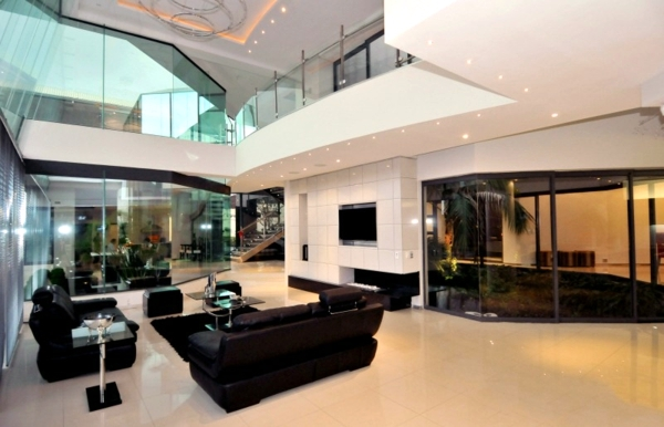 white leather chairs for living room wicker dining indoor architects glamorous concrete house with modern interior design | ideas - ofdesign