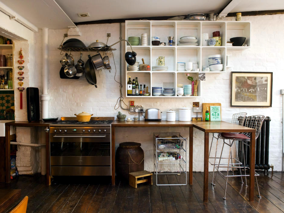 Stove and makeshift kitchen with wooden counter  Interior