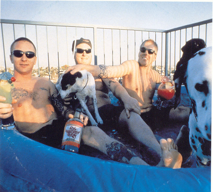 Sublime in a hot tub with their dogs