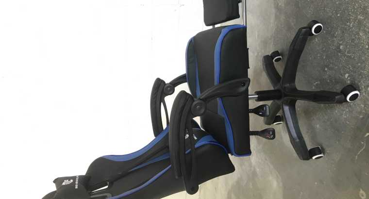 No negotiation, new in box Sevenwolfs gaming chair reclinable back with footrest