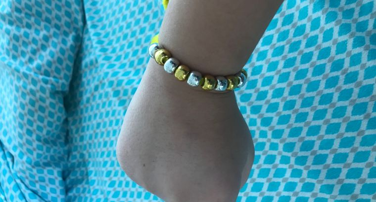 silver and gold beaded sizable braclet