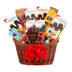 Godiva chocolate makes a great gift for any occasion. This basket is filled with truffles, chocolate bars and chocolate-covered nuts and pretzels to delight someone who has a love for sweets.  12-piece gift basket is filled with assorted treats.  Contains Godiva milk chocolate truffles, milk chocolate strawberry cheesecake truffles, crème brûlee chocolate truffles, assorted dessert truffles, chocolate bars, chocolate cashews, chocolate almonds, chocolate mini pretzels and signature biscuits.