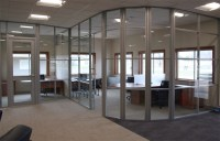 segmented-glass-curved-office-wall | Office Furniture Now