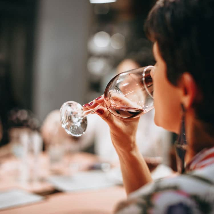 image of a person tasting wine