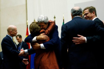 U.S. Secretary of State John Kerry (3rd R) hugs European Union foreign policy chief Catherine Ashton after she delivered a statement during a ceremony next to British Foreign Secretary William Hague (L), Germany's Foreign Minister Guido Westerwelle (R) and French Foreign Affairs Minister Laurent Fabius at the United Nations in Geneva November 24, 2013 (Photo: Denis Balibouse / Reuters).