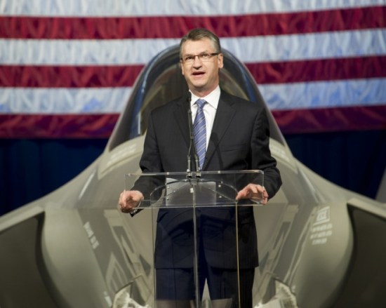 Lockheed exec Larry Lawson speaks at a 2011 rollout ceremony for an F-35 in Florida. <em>Photo: Lockheed Martin</em>