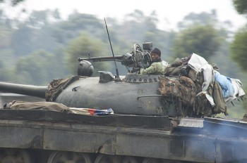 A Congolese army tank drives towards the front a couple of kilometers away from fighting northwest of Goma in Kanyaruchinya (Photo: Joseph Kay).