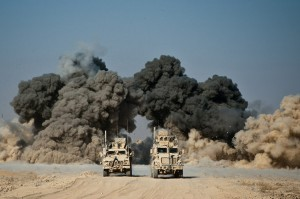 US soldiers of the 502nd Infantry regiment 2nd Batallion Charger company blow up a wall of a compound around Kop Ahmed camp near Kandahar city on November 29, 2010.