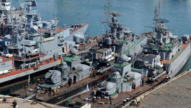 Russian military ships, including former the Ukrainian corvette Khmelnitsky (3rd R), which was seized by pro-Russian forces last week, are moored in the bay of the Crimean city of Sevastopol on March 24, 2014.