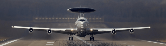 A NATO Airborne Warning and Control Systems (AWACS) aircraft takes off for a flight to Poland from the AWACS air base in Geilenkirchen, near the German-Dutch border. The NATO alliance said it will start reconnaissance flights with AWACS planes from their home base in Geilenkirchen and Waddington, Britain, over Poland and Romania to monitor the situation in neighboring Ukraine, where Russian forces have taken control of Crimea. NATO foreign ministers meeting in Brussels this week suspended all practical cooperation with Russia in protest against its actions in Crimea and asked military commanders to draw up plans to reinforce NATO members in eastern Europe that are fearful about a threat from Russia (Photo: Ina Fassbender/Reuters).