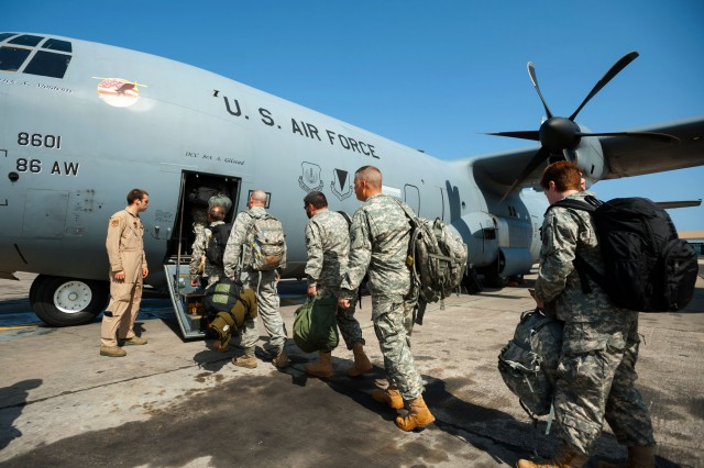 A group of service members, including Soldiers from the U.S. Army Corps of Engineers' Forward Engineering Support Team based in Wiesbaden, Germany, boards a U.S. Air Force C-130 Hercules at Léopold Sédar Senghor International Airport in Dakar, Senegal, Oct. 22, 2014. The engineers are bound for Liberia, where they will build medical treatment units as part of Operation United Assistance, the U.S. Agency for International Development-led, whole-of-government effort to respond to the Ebola outbreak in West Africa. (U.S. Air National Guard photo by Maj. Dale Greer)