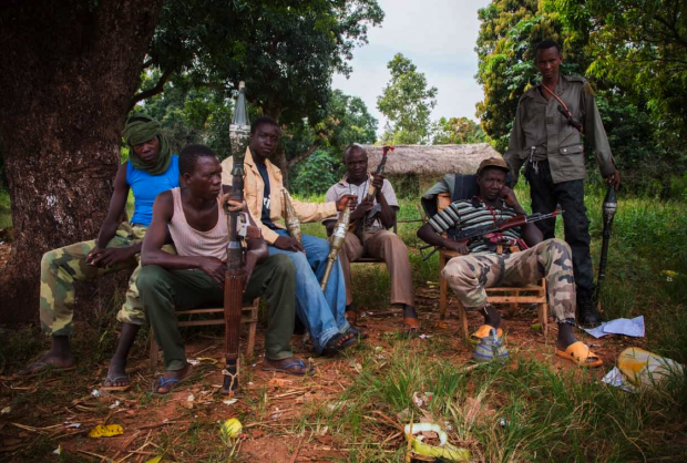 Ex-Seleka fighters at a checkpoint on the road out of Bossangoa, November 4, 2013. They regularly rob local residents who have to cross the checkpoint to retum to town after searching for food in the countryside (Photo: Marcus Bleasdale).