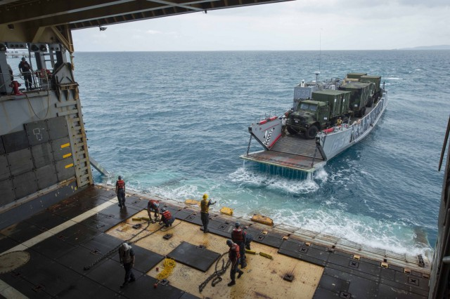 Landing Craft Utility 1633, departs the Whidbey Island-class amphibious dock landing ship USS Ashland (LSD 48) with vehicles assigned to the 31st Marine Expeditionary Unit (31st MEU) after a stern gate marriage. Ashland is part of the Bonhomme Richard Amphibious Ready Group and is conducting joint force amphibious operations in the U.S. 7th Fleet area of responsibility. (U.S. Navy photo by Mass Communication Specialist Seaman Raymond D. Diaz).