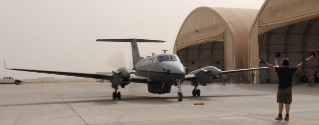 The first MC-12W arrives at Joint Base Balad, Iraq in 2009. Air Force photo.