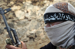 A Somali islamist militant loyal to Hezb al-Islamiya is pictured at a frontline position near the Hodan district in Mogadishu on May 23, 2009. The Shabaab and Hezb al-Islamiya fighters are the main insurgent groups trying to topple President Sharif Sheikh Ahmed's internationally recognised transitional government. Government forces encountered fierce resistance as they tried unsuccessfully yesterday to drive the Islamist insurgents from the Somalian capital of Mogadishu. (Mohamed Dahir, AFP, Getty Images)