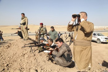 """Kurdish peshmerga troops  on the front line in Khazer. U.S. warplanes bombed Islamist fighters marching on Iraq's Kurdish capital after President Barack Obama said Washington must act to prevent """"genocide""""."""