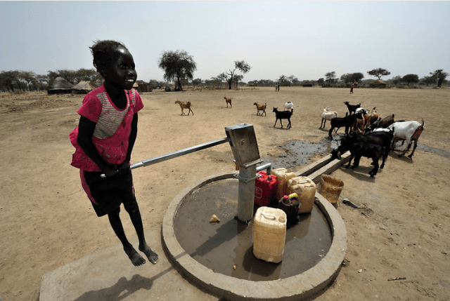 A girl pumps water from a well provided by the Catholic Church in Leu, a village in the contested Abyei region along the border between Sudan and South Sudan. The village was looted and burned in 2011 when soldiers and militias from the northern Republic of Sudan swept through the area, chasing out more than 100,000 Dinka Ngok residents. A few thousand families have returned since northern combatants withdrew in 2012, yet their life is precarious. (Photo: Paul Jeffrey).
