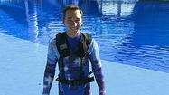 New safety vests worn by whale trainers at SeaWorld - Orlando Fun and Food