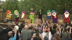 Seven Dwarfs & Tom Staggs as he dedicates the new attraction- Orlando Fun and Food