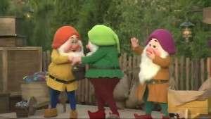 Dwarfs passing buckets of gems - Orlando Fun and Food